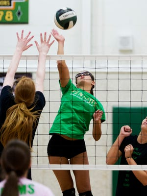 Fort Myers High School volleyball player Briana Correa goes up for a spike during Monday's practice.