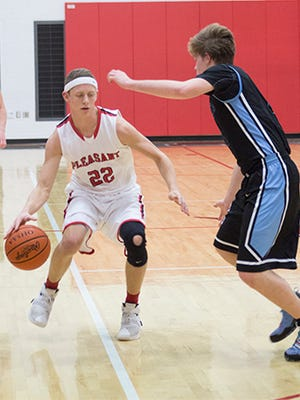 Nico Sansotta of Pleasant dribbles against Ridgedale earlier this season at the Marion County Basketball Holiday Shootout at Elgin High School. The Spartans return home Saturday at 7 p.m. to play Northridge for a Division III sectional championship.