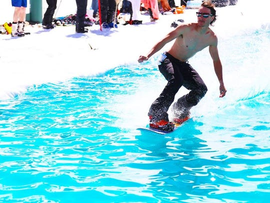 Pond Skim competitors will attempt to glide over a