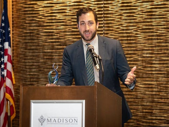 Adam Turer accepts his Greater Cincinnati Foundation's 2018 Emerging Philanthropist Award July 19 for his work with Saturday Hoops.