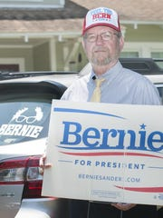 DNC delegate Larry Kellar poses with Bernie Sanders for President campaign paraphernalia before heading to the convention in Philadelphia.