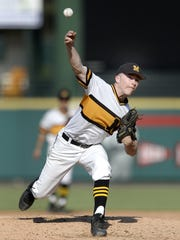 McQuaid's Hunter Walsh releases a pitch during a Class