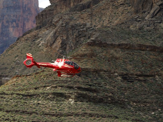 A Papillon Grand Canyon Helicopter helicopter flies in 2017 over the Colorado River through the Hualapai Reservation and the adjacent western part of Grand Canyon National Park.