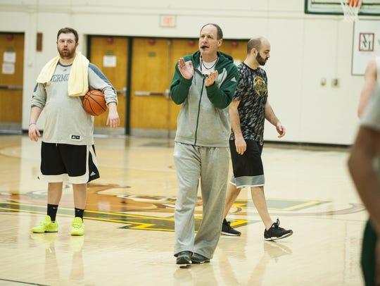 UVM men's basketball head coach John Becker talks to