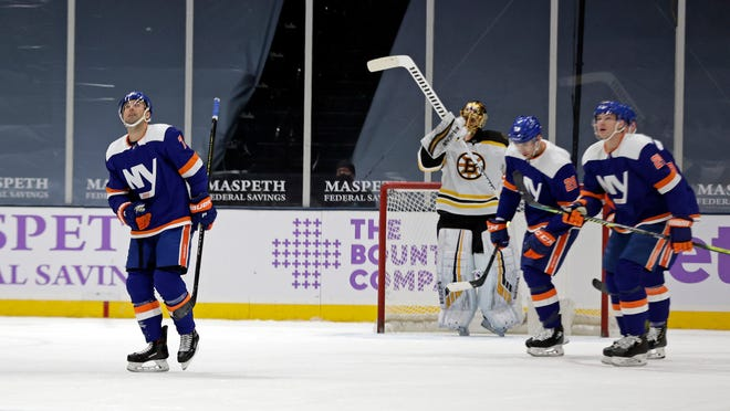New York Islanders right wing Jordan Eberle (7) skates to the bench after scoring a goal past Boston Bruins goaltender Tuukka Rask during the first period of an NHL hockey game Saturday, Feb. 13, 2021, in Uniondale, N.Y. (AP Photo/Adam Hunger)
