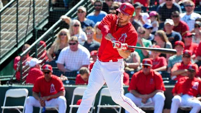 Mar 13, 2015: Los Angeles Angels left fielder Matt Joyce (20) hits a sacrifice fly in the first inning against the San Diego Padres at Tempe Diablo Stadium.