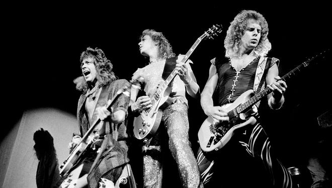The triple-guitar sonic attack of Jack Blades, left, Jeff Watson and Brad Gillis sets the tone for the Night Ranger concert Aug. 21, 1985, at Municipal Auditorium.