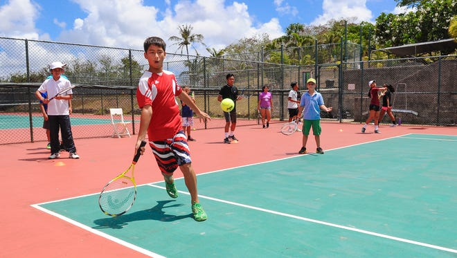 Summer camper Mark Imazu, 12, prepares to return a volley during the Summer Tennis Camp, hosted by the Tennis Academy of Guam at the Sheraton Laguna Guam Resort in Tamuning on Monday, June 6. Enrolled youths, ranging in ages of eight-years-old and 16-years-old, participating in the program receive tennis lessons and enjoy swimming at the resort, said Joe Cepeda, camp director.