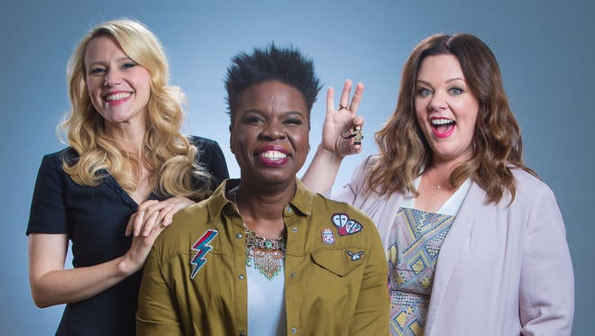 The new 'Ghostbusters' (from left): Kate McKinnon, Leslie Jones and Melissa McCarthy. McCarthy is holding a Ghostbuster Lego character as a stand-in for Kristen Wiig , the fourth Ghostbuster.