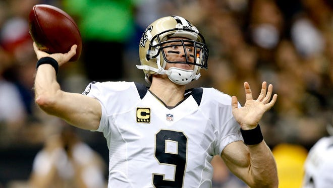 Sep 22, 2013; New Orleans, LA, USA; New Orleans Saints quarterback Drew Brees (9) against the Arizona Cardinals during the first half of a game at Mercedes-Benz Superdome. The Saints defeated the Cardinals 31-7.