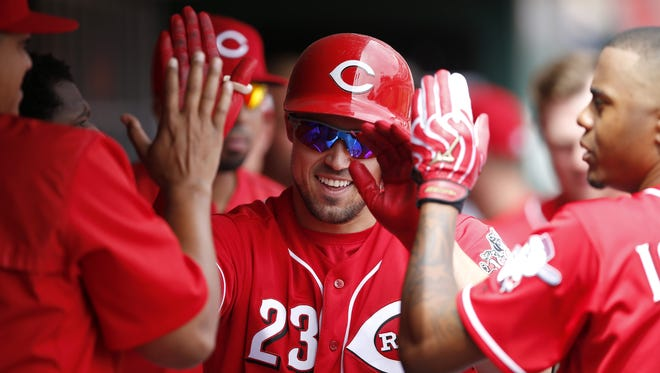 Reds left fielder Adam Duvall is congratulated in the dugout after hitting a home run against the Rockies April 20 at Great American Ball Park.