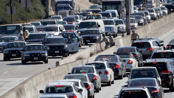 Los Angeles police officers stop traffic on the U.S.