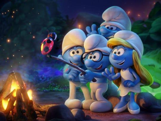"Hefty (Joe Manganiello), Brainy (Danny Pudi), Clumsy (Jack McBrayer) and Smurfette (Demi Lovato) use Snappy to take a selfie in ""Smurfs: The Lost Village."""