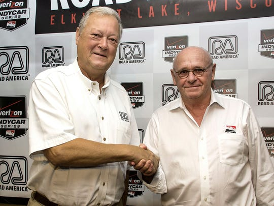George Bruggenthies, left, and Derrick Walker, INDYCAR President of Competition and Operations, pose following the announcement that Indy car racing will return to the track in 2016.