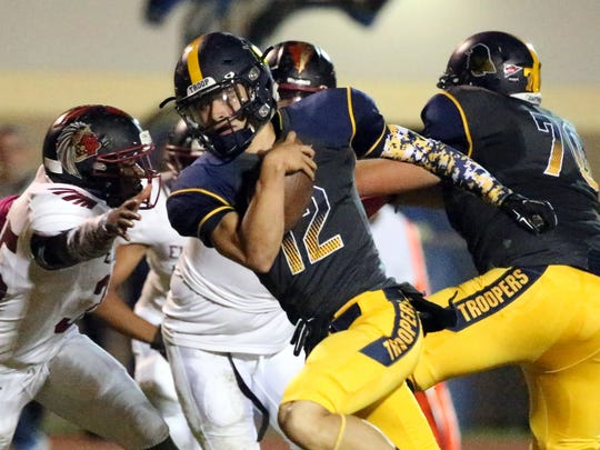 Eastwood quarterback Mark Torrez, 12, rushes into the end zone for a touchdown against El Dorado on Friday night at Eastwood.