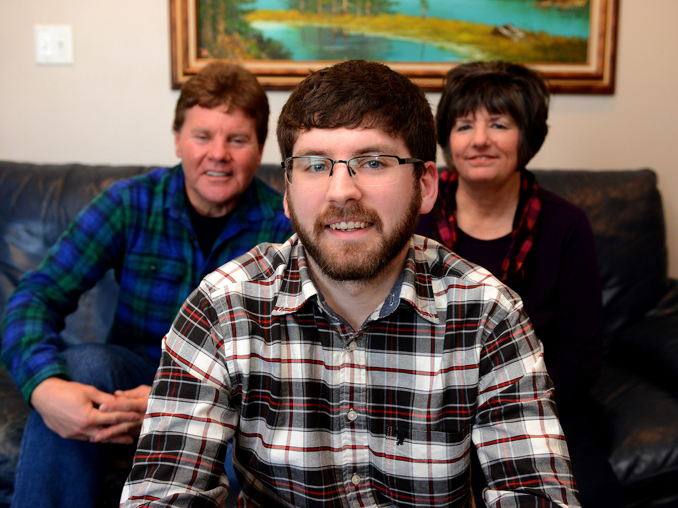 Aaron Emerson, 24, sits with his parents Wes and Rhonda, Wednesday, Jan. 20, 2016, at their home in Mason. Aaron Emerson is in recovery of his heroin addiction. His parents have a prescription for Narcan, an anti-overdose drug, that they keep in the house in case he relapses. Wes is pastor at New Life Fellowship church in Leslie.