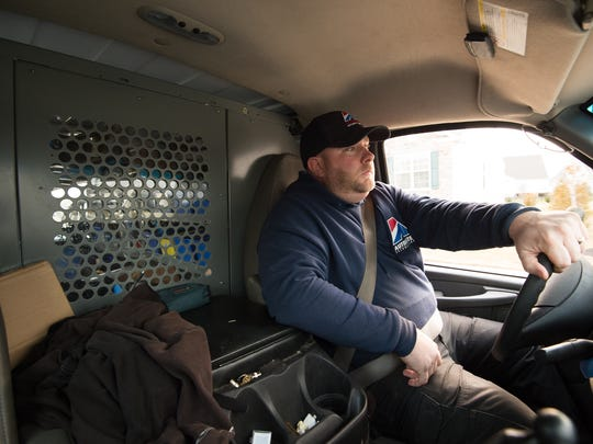 "Middletown resident Brian Wyre drives the work van he uses to commute to New Jersey and beyond for his job installing security equipment. He is what the U.S. Census Bureau calls a ""mega commuter,"" someone who spends more than 90 minutes one way commuting for work."