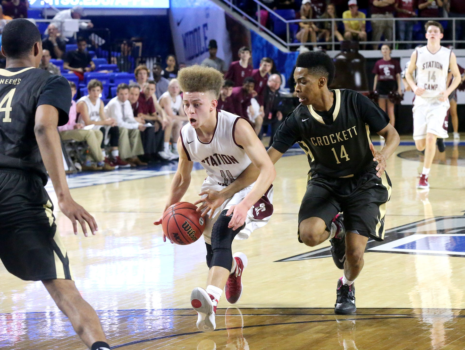 """Station Camp's Chase Freeman (11) rushes toward the basket as David Crockett""""s Darian Delapp (14) tries to steal the ball during the State Tournament Quarterfinal game Wednesday at MTSU."""