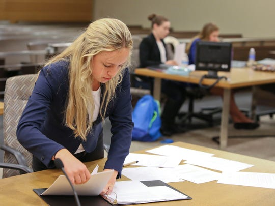 Allie Fulginiti from Wilmington Friends conducts witness testimony while her team practices for the upcoming national mock trial competition in a courtroom at the New Castle County Courthouse Saturday.