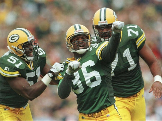 LeRoy Butler (36) celebrates with teammates Brian Williams