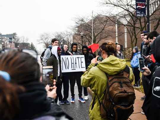 Ricky Bugg Jr. (center) poses for a picture as members of the Annville Township community and members of Lebanon Valley College held a march and rally to end racism on Tuesday, Feb. 7, 2017. The march and rally was in response after Chris Behney, founder of Just Wing It, used a racial slur against an African American Lebanon Valley College student on Sunday, Jan. 22, 2017.