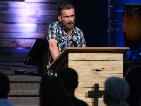 "Brandon Barnett, host of the podcast ""Searching for Ghosts"" spoke at a candlelight vigil in remembrance of Cayce Lynn McDaniel, Wednesday, August 16, 2017, 21 years after her disappearance."