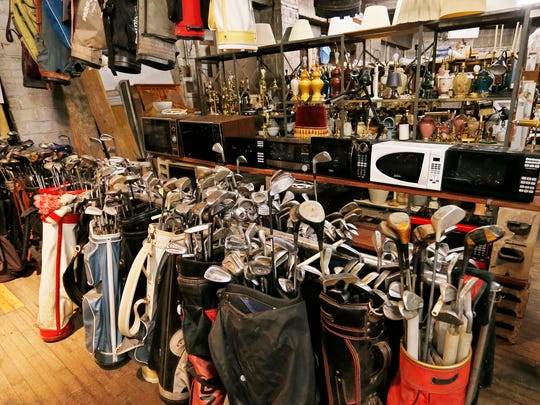 Golf clubs and bags, microwave ovens and lamps are