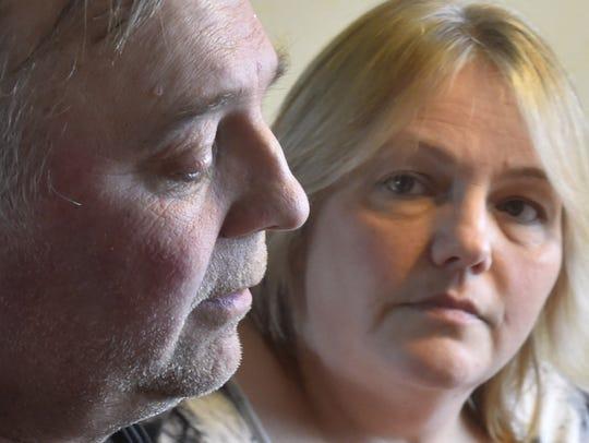 Karen Cihlar listens to her husband Dale Cihlar talk