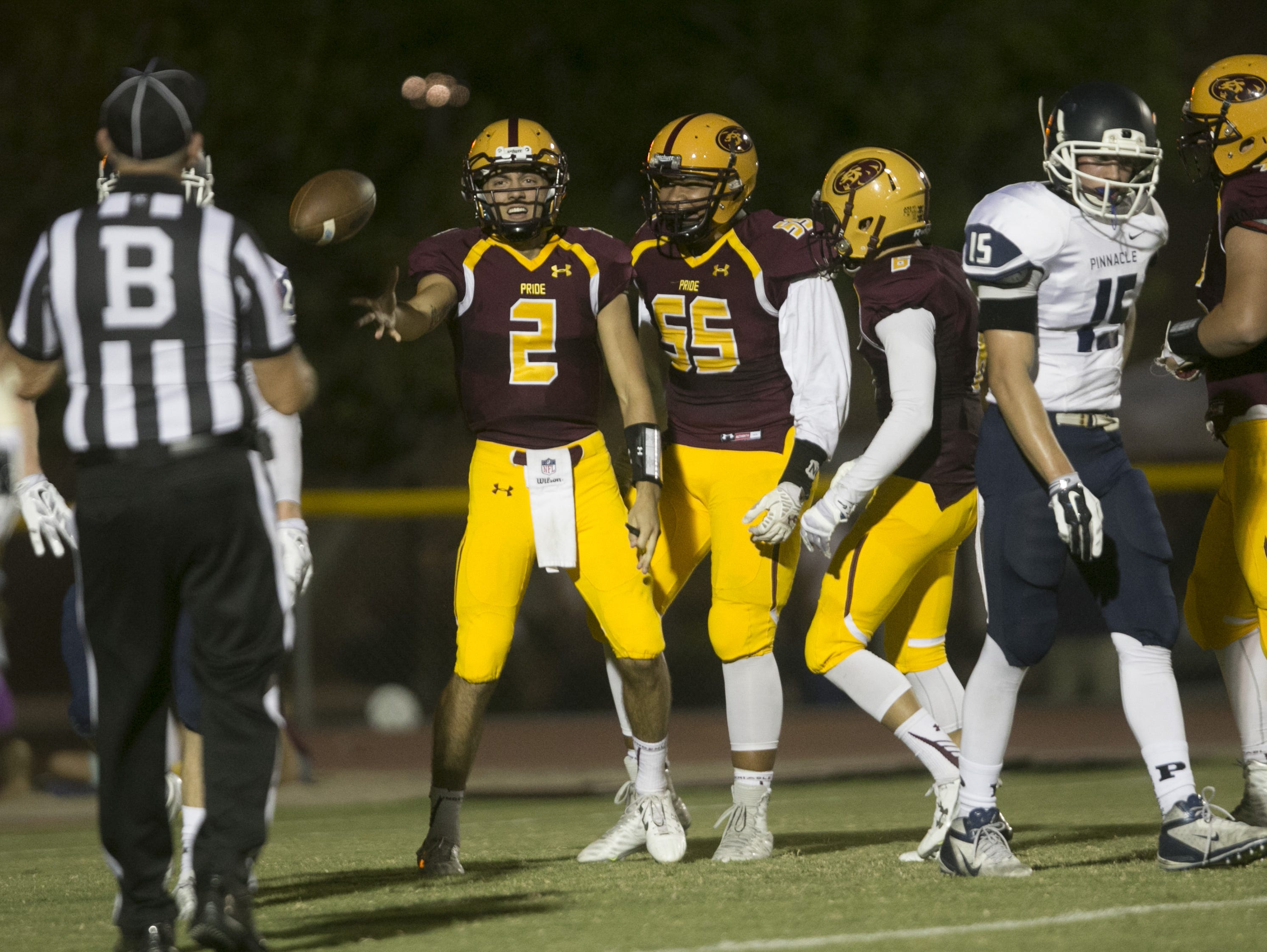 Mountain Pointe's Jack Smith tosses the ball to the referee after scoring a running TD against Pinnacle at Mountain Pointe High School in Phoenix, AZ on September 25, 2015.