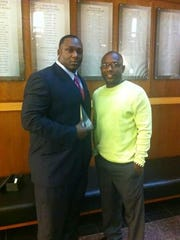 """Jerrell Powe and Melvin Mathis. Mathis is Powe's """"right-hand"""