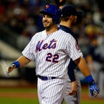 Mets catcher Kevin Plawecki smiles after his first major league hit.