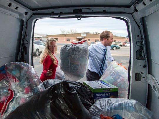 The Spectrum news staff in Cedar City drops off donations at the Iron County Alternative Programs office, Wednesday, Dec. 14, 2016.