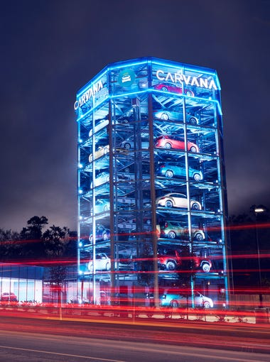 "A ""car vending machine"" at a Carvana site in Houston, Texas. The online used car seller stores vehicles awaiting delivery to customers in these eye-catching structures, which used robotic technology that is also being incorporated into automated parking garages."
