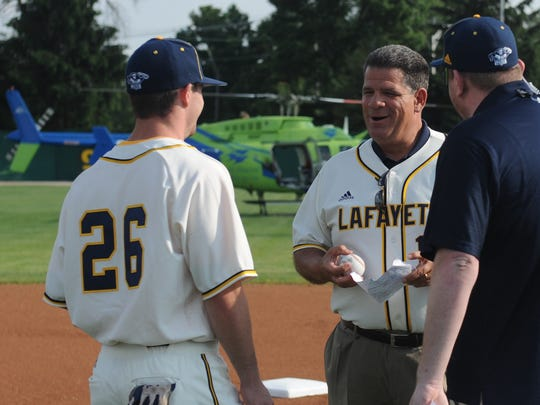 Lafayette mayor Tony Roswarski visits with Aviators outfielder Aaron Bence before Wednesday's game.