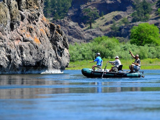 Anglers fly-fish the Missouri River below Craig on