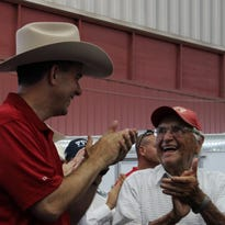 Gov. Scott Walker shares a smile with a Wisconsin resident during the Governor's Blue Ribbon Livestock Auction at the Wisconsin State Fair on Aug. 10. The Governor has been traveling across the state holding listening sessions with small groups of residents.