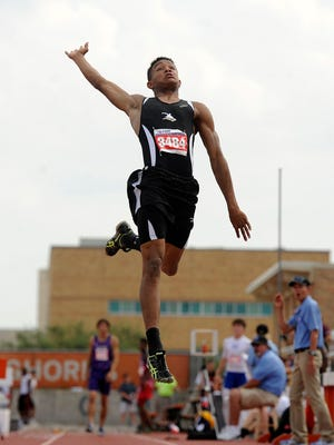 Cisco's Taylor Massey soars into the pit in the Class 3A boys long jump during the UIL Track and Field State Championships on Friday, May 13, 2015, at Mike A. Myers Stadium in Austin.