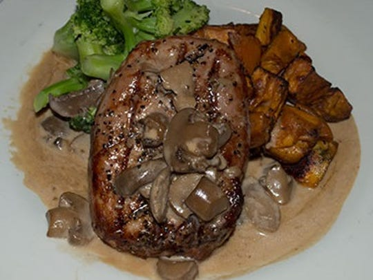 The grilled pepper crusted pork bibeye at the Stage House Tavern with roasted sweet potatoes, broccoli and mushroom brandy cream sauce.