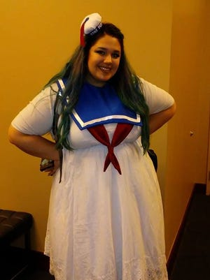 """Keeley Shoup cosplays as the Stay Puft Marshmallow Man from """"Ghostbusters"""" at Gen Con on Saturday."""