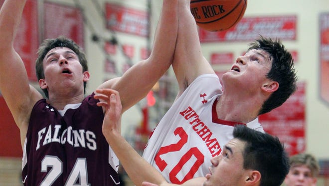 Albertus Magnus' Collin Crispino (24) fights for a rebound with Tappan Zee's Kevin Lynch  during their game at Tappan Zee Jan. 10, 2017.