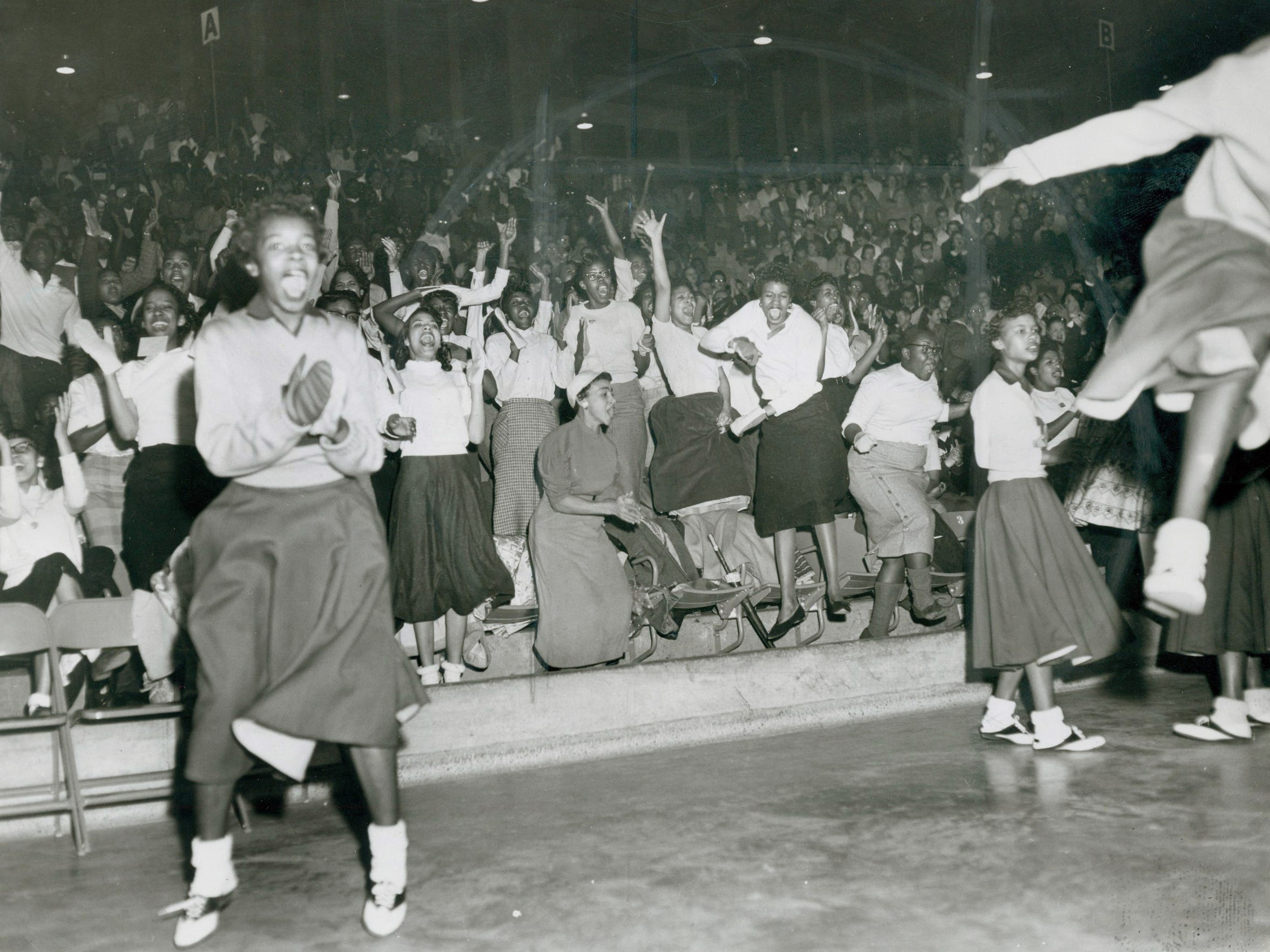 Fans celebrate as Evansville Lincoln, in its waning days as the city's all-black high school, upset Bosse 42-37 in the Evansville Sectional at Roberts Stadium on Feb. 27, 1958.