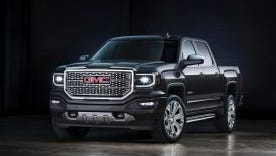 The 2016 GMC Sierra pickup will feature minor changes including new front fascia and grille, and C-shaped LED daytime running lights.