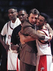 UC coach Bob Huggins and guard Anthony Buford celebrate the Bearcats' win over Memphis State, which sent UC to the 1992 Final Four.