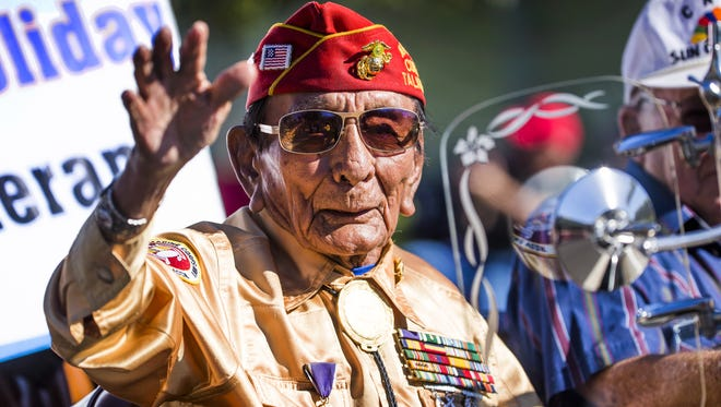 Marine Corps veteran Sam Holiday heads south on Central Avenue at West Georgia Avenue in Phoenix in the annual Veterans Day Parade Nov. 11, 2016.
