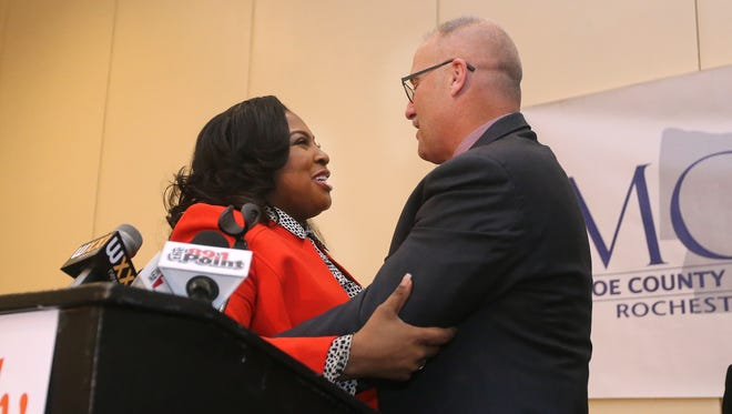 Mayor Lovely Warren congratulates newly elected Monroe County Sheriff Todd Baxter.