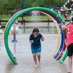 The opening day at the Hawk Island splash pad drew some youngsters who didn't mind the cool water and temperatures Sunday, May 24, 2015.