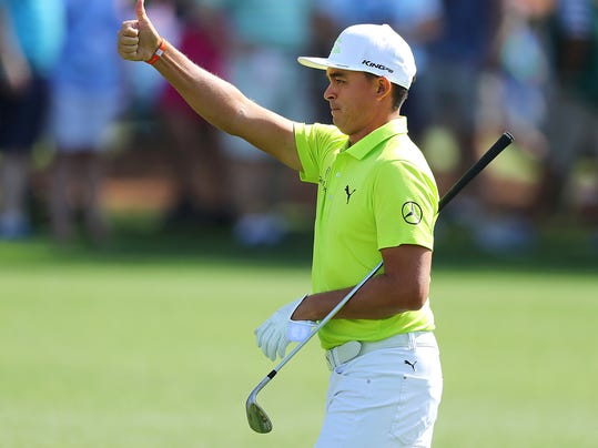 Rickie Fowler gives the gallery a thumbs up hitting his fairway shot close to the cup on the third hole during a practice round for the Masters golf tournament at Augusta National Golf Club in Augusta, Ga., Monday, April 2, 2018. (Curtis Compton/Atlanta Journal-Constitution via AP)