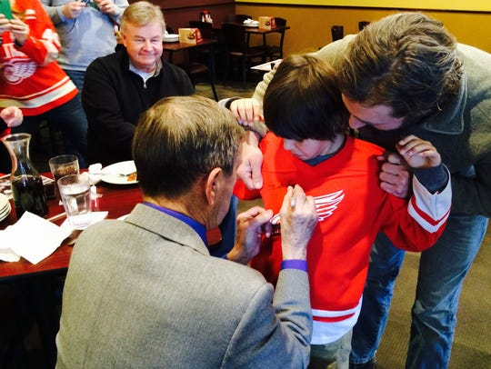 Detroit Red Wings great Ted Lindsay signs the jersey