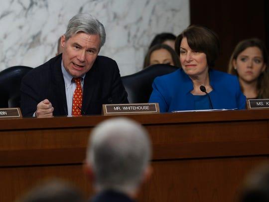 Sen. Sheldon Whitehouse, D-R.I., accompanied by Sen. Amy Klobuchar, D-Minn., questions Neil Gorsuch on March 21, 2017, during his confirmation hearing.