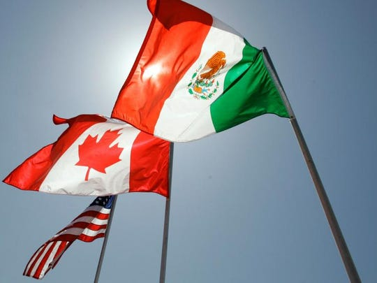 National flags representing the United States, Canada, and Mexico fly in the breeze in New Orleans where leaders of the North American Free Trade Agreement met in April 2008.